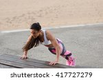 strong fitness woman doing push ... | Shutterstock . vector #417727279