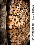 Small photo of Woodpile from the split logs, boards firewood of an alder. Natural background.