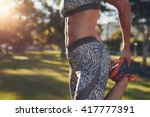 midsection of sporty woman... | Shutterstock . vector #417777391
