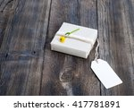 gift box with flower on wooden... | Shutterstock . vector #417781891