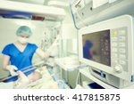 Small photo of intensive care unit female doctor with baby infant