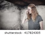 blonde woman with headache... | Shutterstock . vector #417824305