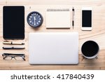 topview of wooden desktop with... | Shutterstock . vector #417840439