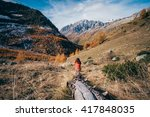 girl watching the italian alps... | Shutterstock . vector #417848035