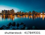 Stock photo vancouver skyline reflection at sunset 417849331