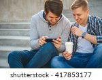 two young men sitting on the... | Shutterstock . vector #417853177