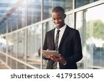 young african man in suit using ... | Shutterstock . vector #417915004