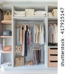 white wardrobe with shirts and... | Shutterstock . vector #417925147