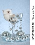 Stock photo ragdoll kitten sleeping inside large champagne glass with many disco mirror balls 41792713