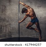shirtless man pole dancing on a ... | Shutterstock . vector #417944257
