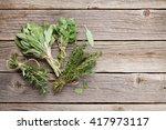 fresh garden herbs on wooden... | Shutterstock . vector #417973117