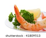 A Shrimp appetizer with lemon and parsley - stock photo
