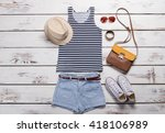 tank top and blue shorts. lady... | Shutterstock . vector #418106989