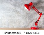 red lamp on wooden desk in... | Shutterstock . vector #418214311