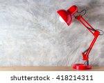 red lamp on wooden desk in...   Shutterstock . vector #418214311
