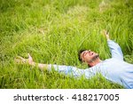 happy pretty man lying on the... | Shutterstock . vector #418217005