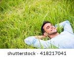 Smiling Pretty Young Man Lying  ...