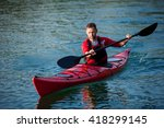 man paddles a red kayak on the... | Shutterstock . vector #418299145