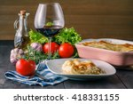 Small photo of Potion of lasagne on plate. mediterranean dinned concept