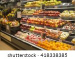 blurred shelf with fruits on a... | Shutterstock . vector #418338385