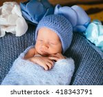 little baby in the blue knitted ... | Shutterstock . vector #418343791