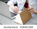 young woman leafs notebook | Shutterstock . vector #418451284