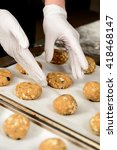 hands in gloves putting on... | Shutterstock . vector #418468147