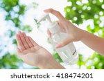 female using hand press bottle... | Shutterstock . vector #418474201