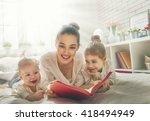 happy loving family. pretty... | Shutterstock . vector #418494949