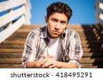 handsome teenager outdoors ... | Shutterstock . vector #418495291