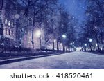night snowfall trees background | Shutterstock . vector #418520461