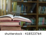 glasses on the books in library ... | Shutterstock . vector #418523764