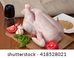 whole raw chicken on a wooden... | Shutterstock . vector #418528021