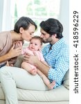 parents kissing son while... | Shutterstock . vector #418596229