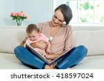 mother showing picture book to... | Shutterstock . vector #418597024