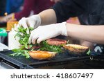 chef making beef burgers... | Shutterstock . vector #418607497
