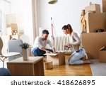 young couple unpacking... | Shutterstock . vector #418626895