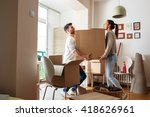 young couple carrying big... | Shutterstock . vector #418626961