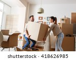 young couple carrying big... | Shutterstock . vector #418626985