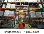 a forklift truck passing though ... | Shutterstock . vector #418635325