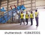 staff wearing reflective vests... | Shutterstock . vector #418635331