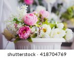 Pink And White Flowers In A...