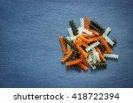 tri color fusilli pasta on... | Shutterstock . vector #418722394