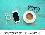 phone and coffee on vintage... | Shutterstock . vector #418738981