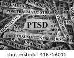 Small photo of Torn pieces of paper with abbreviate PTSD. Posttraumatic stress disorder. Concept Image. Closeup.