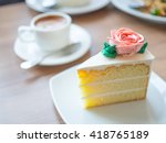 Slice Vanilla Cake With Rose...