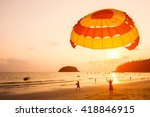 Silhouette Of Parasailing At...