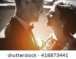 bride and groom posing in a... | Shutterstock . vector #418873441