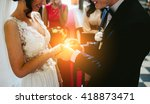 groom wears the ring on the... | Shutterstock . vector #418873471