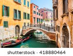 Scenic Canal With Bridge And...